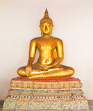 Golden sitting Buddha statue Stock Photography