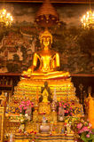 Golden sitting buddha in Thai church. Stock Photos