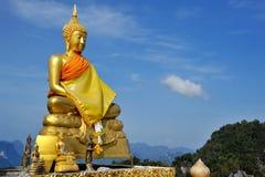 Golden sitting buddha Royalty Free Stock Photos