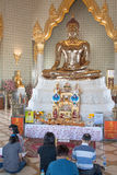 Golden Sitting Buddha in Wat Traimit. Praying people in Buddhist Temple in Chinatown District in Bangkok. Thanon Mittaphap Thai-China (Thailand Royalty Free Stock Image