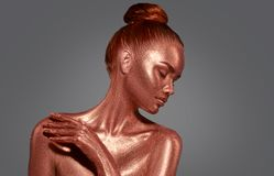 Golden skin beauty woman portrait. Fashion model girl with holiday golden makeup stock photography