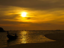 Golden sky. Sunset with boat at the sea Stock Photos