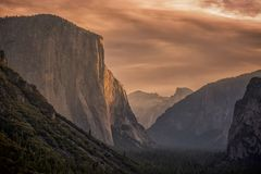 A golden sky over Yosemite National Park. This picture shows a golden sky over the Yosemite national park stock images
