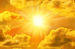 Golden Gold Sky Sun Sunny Clouds. A gold sky with the sun, clouds and sunbeams Royalty Free Stock Photos