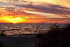 Golden Sky Sunset on Lake Michigan - Michigan USA Royalty Free Stock Photos