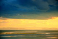 Golden sky under dark cloud Royalty Free Stock Photos