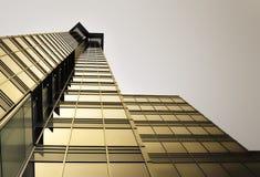 Golden Skyscraper. Bronze glass tower against dark sky Stock Photo