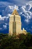 Golden skyscraper on blue sky background royalty free stock image
