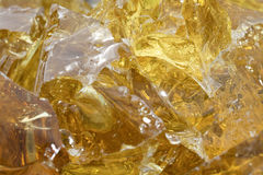 Golden Slag Glass. Golden rock glass (slag glass) used in the glass industry in the manufacturing of color glass. Background color & texture Royalty Free Stock Photography