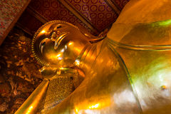 The golden sleeping buddha statue Stock Photography