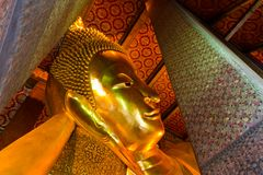 The golden sleeping buddha statue Royalty Free Stock Photos