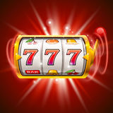 Golden slot machine wins the jackpot.  on red background. Royalty Free Stock Image