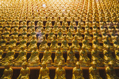 Golden Small Buddha Statues inside Yakcheonsa Temple. Jeju, South Korea Stock Photo