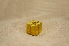 Golden small present Royalty Free Stock Photos