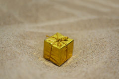 Golden small present Royalty Free Stock Photo