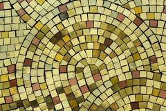 Golden smalt on the mosaic panel stock image