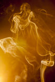 Golden smoke Royalty Free Stock Image
