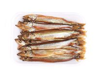 Golden smoke sprats Stock Image