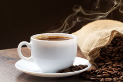 Golden smoke taking away from coffee Royalty Free Stock Images