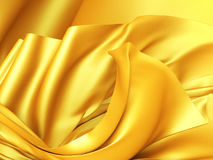 Golden smooth satin silk fabric flying waves. Luxury beautiful b Stock Photo