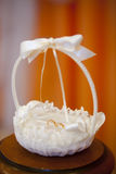 Golden smoth wedding rings in white silk basket with pearls and ribbons Stock Image