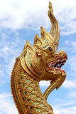 Golden snake sculpture in Chiang Mai temple, Thailand. Blue sky and Golden snake sculpture in Chiang Mai temple, Thailand stock photo