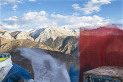 Golden snow-capped mountains in Tibet Stock Images