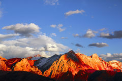 Golden snow-capped mountains in Tibet Royalty Free Stock Images