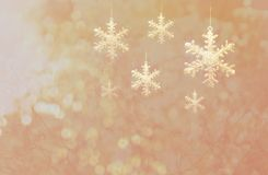 Golden snow flake with bokeh glitter pink Christmas background. Golden snow flake with light bokeh glitter pink Christmas background Royalty Free Stock Images