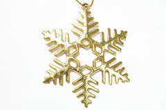 Golden snow flake on white background royalty free stock images