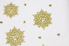 Golden snow flakes Royalty Free Stock Photo