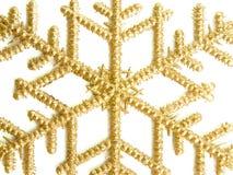 Golden snowflake Stock Photos