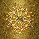 Golden snowflake on the aged gold Royalty Free Stock Images