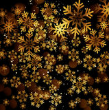 Golden snowflake on a dark background Royalty Free Stock Images