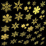 Golden snowflakes Stock Photos