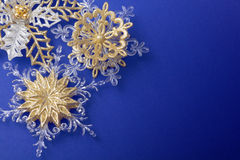 Golden snowflakes background stock image