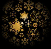 Golden snowflakes on black background Royalty Free Stock Images