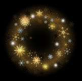 Golden snowflakes on a black background Royalty Free Stock Photo