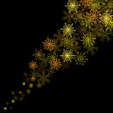 Golden snowflakes blizzard in the darkness Stock Image