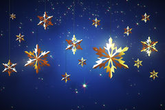 Golden snowflakes on blue background Royalty Free Stock Image