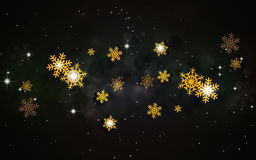 Golden Snowflakes on Dark Background Royalty Free Stock Images