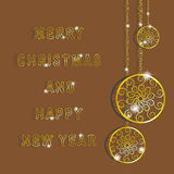 Golden snowflakes for Merry Christmas and Happy New Year. Gold circles with pattern hanging on a gold chain Stock Images