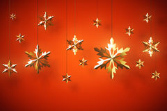 Golden snowflakes on red background Stock Photo