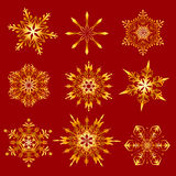 Golden snowflakes on a red background Stock Photo