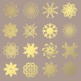 Golden snowflakes set. Set of 16 hand drawn decorative golden snowflakes, design elements. Christmas and New Year background. Winter theme royalty free illustration