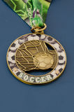 Golden soccer campaign medal. With blue background (nikon raw file was provided Stock Photo