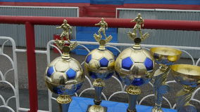 Golden soccer trophy. Cup in the form of ball players.  stock video footage
