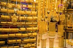Golden souk in Dubai. DUBAI, UAE - JANUARY 31: Gold on the famous Golden souk in Dubai Deira market on 31 January 2016, UAE. Deira is an old commercial center of Stock Photo