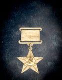 Golden Soviet Star Medal on Stone Royalty Free Stock Photo