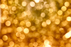 Golden Sparkle. Defocused golden light. Blurry lights Royalty Free Stock Photography